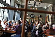 A window pane frames the open dining area at The Kenwood restaurant in Minneapolis, MN.