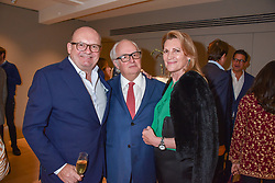 Left to right, Michael Spencer, Gerry Farrell and Sarah, Marchioness of Milford-Haven at a private view of recent work by Georgiana Anstruther held at the Sladmore Gallery, 32 Bruton Place, London England. 08 November 2018. <br /> <br /> ***For fees please contact us prior to publication***