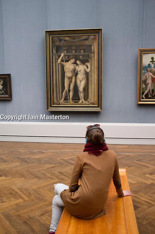 Visitors looking at old masters paintings at Gemaldegalerie at Kulturforum in Berlin Germany