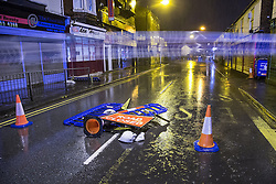 © Licensed to London News Pictures . 15/01/2015 . Middleton , UK . Road closed signs and barriers blow over as high winds blow out the gable end of a building on Market Place , Middleton , closing the road, as heavy rain and winds cause disruption across the UK .  Photo credit : Joel Goodman/LNP