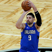 ORLANDO, FL - MARCH 01: Nikola Vucevic #9 of the Orlando Magic attempts a shot against the Dallas Mavericks during the first half at Amway Center on March 1, 2021 in Orlando, Florida. NOTE TO USER: User expressly acknowledges and agrees that, by downloading and or using this photograph, User is consenting to the terms and conditions of the Getty Images License Agreement. (Photo by Alex Menendez/Getty Images)*** Local Caption *** Nikola Vucevic