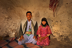 """Majed, 27, and his bride Tahani, 8, are seen in Hajjah, Yemen, July 26, 2010. """"Whenever I saw him, I hid. I hated to see him,"""" Tahani recalls of the early days of her marriage."""