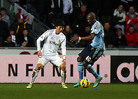 Wednesday 09 February 2013..Pictured L-R: Ki Sung Yueng of Swansea against Stephane Mbia of QPR..Re: Barclay's Premier League, Swansea City FC v Queen's Park Rangers at the Liberty Stadium, south Wales.