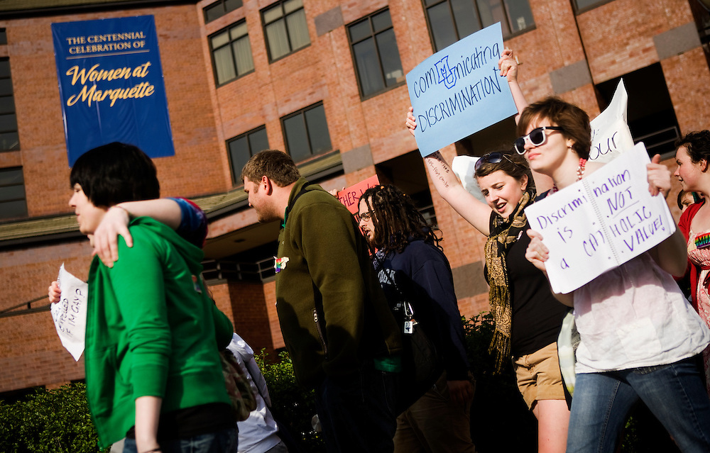 Students protest Marquette University's decision to rescinded an offer for the position of dean of the Helen Way Klingler College of Arts and Sciences to Seattle University professor Jodi O'Brien, an open lesbian. While Marquette University sated the decision to rescind the offer was not based on O'brien's sexuality, many viewed it as a violation to both Marquette's statement of mission and identity as well as its LGBT community.<br /> <br /> Students protest outside Marquette's Alumni Memorial Union.