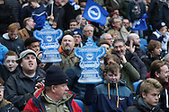 football fans, football supporters with foam FA Cup during Brighton & Hove Albion and Milton Keynes Dons at the American Express Community Stadium, Brighton and Hove, England on 7 January 2017.