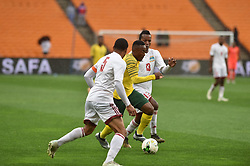 South Africa: Johannesburg: Bafana Bafana player Lebohang Maboe battle for the ball with Seychelles players Jones Joubert Colin Esther during the Africa Cup Of Nations qualifiers at FNB stadium, Gauteng.<br />Picture: Itumeleng English/African News Agency (ANA)