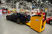 An employee works at the Ferrari auto plant in Maranello, Italy, on Monday, July 18, 2011.<br /> Photo: Victor Sokolowicz / Bloomberg