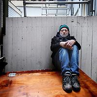 Nederland, Amsterdam , 13 december 2013.<br /> Dakloze Reza Hedayat. ontving een kerstbonus en gaf het weer terug.<br /> Foto:Jean-Pierre Jans