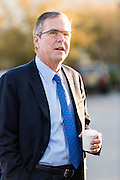 Former Florida Governor and potential Republican presidential candidate Jeb Bush walks to an early morning GOP breakfast event with a coffee in hand March 18, 2015 in Myrtle Beach, South Carolina.