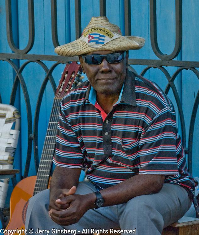 Cuban man passing time in Old Havana, Habana Vieja, Cuba.