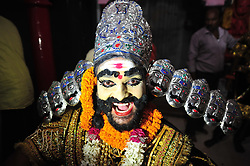 September 26, 2016 - Allahabad, Uttar Pradesh, India - Allahabad: An Artist dressed as Demon king Rawan performg during a religious procession Ravan ki Barat in Allahabad on September 26, 2016, held to mark the Dussehra festival. The name Dussehra is derived from Sanskrit Dasha-hara literally means removal of ten referring to Lord Rama's victory over the ten-headed demon king Ravana. Dussehra is celebrated on the tenth day of the month of Ashwin according to the Hindu calendar which corresponds to September or October of the Gregorian calendar. (Credit Image: © Prabhat Kumar Verma via ZUMA Wire)