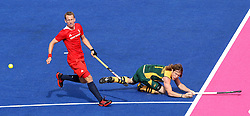 Jonathan Robinson of South Africa gets the cross in during the men's hockey match between South Africa and Great Britain held at the Riverbank Arena at Olympic Park in London as part of the London 2012 Olympics on the 1st August 2012..Photo by Ron Gaunt/SPORTZPICS