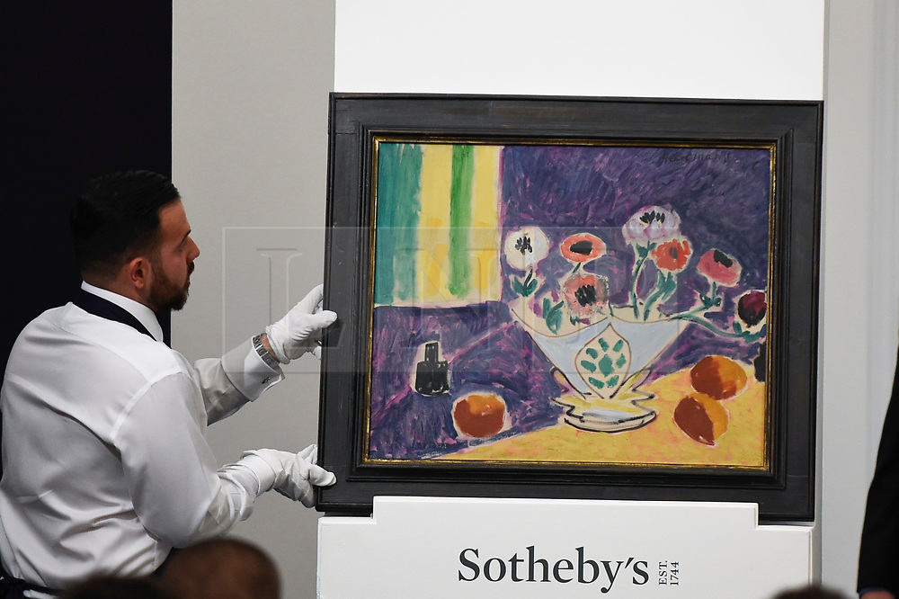 © Licensed to London News Pictures. 19/06/2019. LONDON, UK. A technician presents ''Vase D'Anémones'' by Henri Matisse, (Est. £4,000,000 - 6,000,000) which sold for a hammer price of £3,600,000 at Sotheby's Impressionist & Modern art evening sale in New Bond Street. This is the first major evening sale to take place after Sotheby's agreed to a takeover by media and telecoms billionaire Patrick Drahi in a deal valued at $3.7bn (£2.9bn).  The big five global auction houses (Sotheby's, Christie's, Bonhams, Phillips and China Guardian Auctions) will now be held privately.  Francois Pinault, another French billionaire, owns Sotheby's traditional rival Christie's.   Photo credit: Stephen Chung/LNP