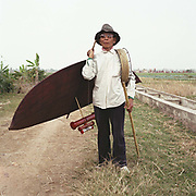 Portrait of a kite maker holding a traditional bamboo kite he has made in Xuan Lai village, Bach Ninh province, Vietnam