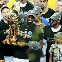 12 June 2017: Golden State Warriors forward Draymond Green (23) is seen with the Larry O'Brien NBA Championship Trophy  during the Golden State Warriors 129-120 victory over the Cleveland Cavaliers, in game 5 of the 2017 NBA Finals, at the Oracle Arena, Oakland, California, USA.