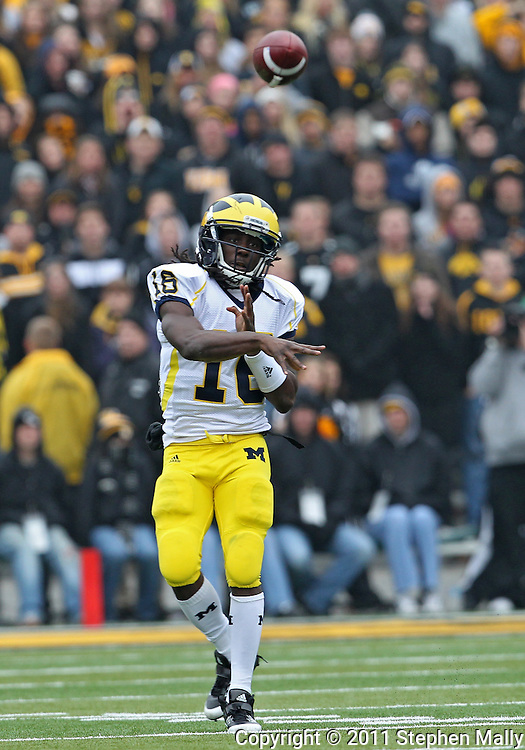 November 05, 2011: Michigan Wolverines quarterback Denard Robinson (16) passes the ball during the second quarter of the NCAA football game between the Michigan Wolverines and the Iowa Hawkeyes at Kinnick Stadium in Iowa City, Iowa on Saturday, November 5, 2011. Iowa defeated Michigan 24-16.