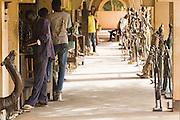 Vendors wait in their stores at the Village Artisanal de Ouagadougou, a cooperative that employs dozens of artisans who work in different mediums, in Ouagadougou, Burkina Faso, on Monday November 3, 2008.
