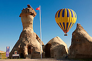 """Pictures & images of hot air balloons over the fairy a chimney rock Police Station at """"Pasaba Valley"""" near Goreme, Cappadocia, Nevsehir, Turkey .<br /> <br /> If you prefer to buy from our ALAMY PHOTO LIBRARY  Collection visit : https://www.alamy.com/portfolio/paul-williams-funkystock/cappadocia-balloons.html<br /> <br /> Visit our TURKEY PHOTO COLLECTIONS for more photos to download or buy as wall art prints https://funkystock.photoshelter.com/gallery-collection/3f-Pictures-of-Turkey-Turkey-Photos-Images-Fotos/C0000U.hJWkZxAbg ."""