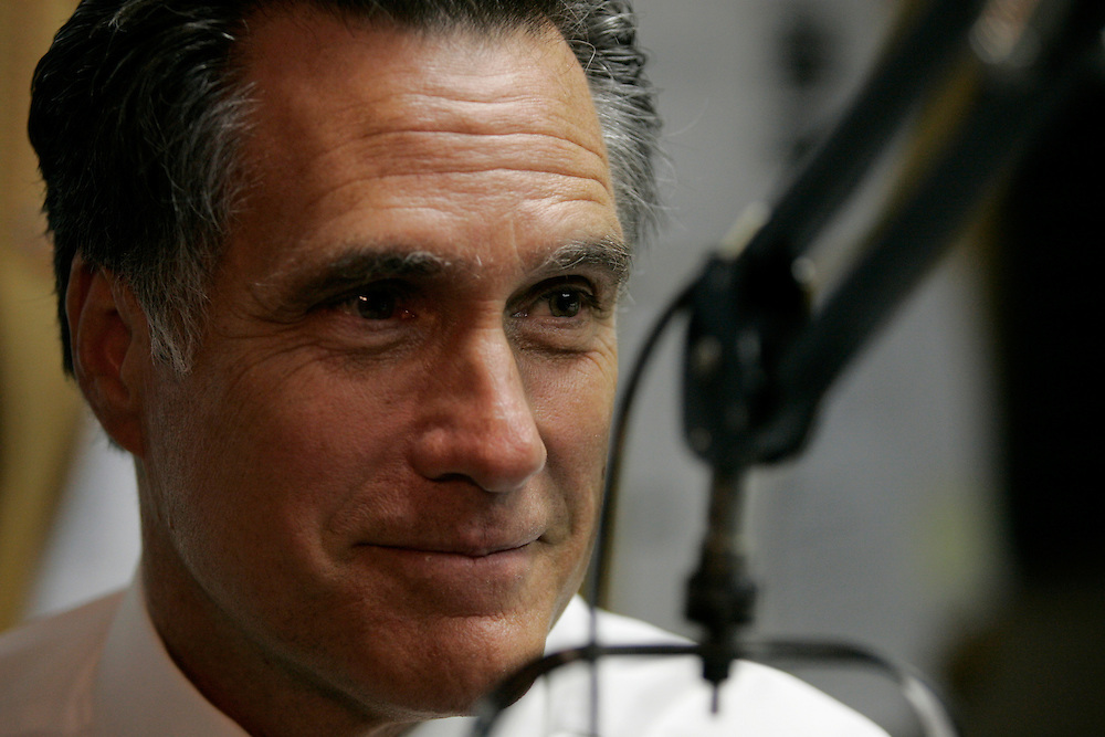 Governor Mitt Romney talks to listeners on Michael McKoy's radio show at WOW FM in Urbandale, Iowa.