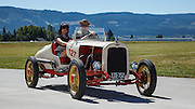 USA, Oregon, Hood River, Western Antique Aeroplane and Automobile Museum, volunteers in an old Chevy speedster.