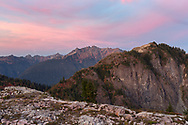 Sunset light over Shuksan Arm and Mount Sefrit in the North Cascades Range.  Photographed from Kulshan Ridge in the Mount Baker-Snoqualmie National Forest in Washington State, USA.