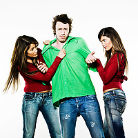 studio shot pictures on isolated background of two sisters twin women friends fighting for a man