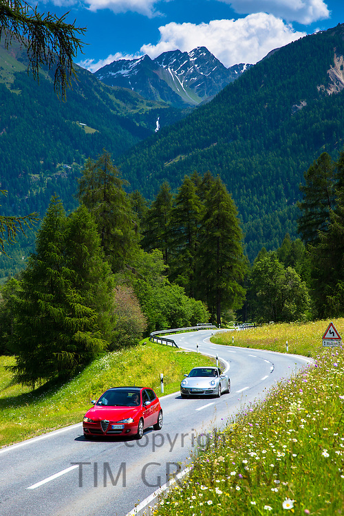 Alfa Romeo and Porsche 911 on touring holidays in the Swiss Alps, Swiss National Park, Switzerland