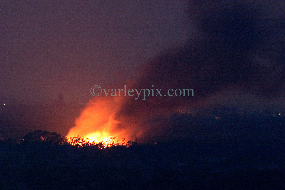 04 Sept  2005. New Orleans, Louisiana. Post hurricane Katrina. <br /> A fire rages out of control in Mid City, New Orleans.<br /> Photo; ©Charlie Varley/varleypix.com