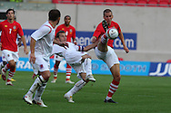 Steve Morison of Wales battles for the ball with Rene Peters .  friendly international match, Wales v Luxembourg at the Parc y Scarlets stadium in  Llanelli on Wed 11th August 2010. pic by Andrew Orchard, Andrew Orchard sports photography,