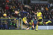Oxford United's Josh Ruffels (14) heads clear under pressure from Burton Albion forward Lucas Akins (10) during the EFL Sky Bet League 1 match between Burton Albion and Oxford United at the Pirelli Stadium, Burton upon Trent, England on 2 February 2019.