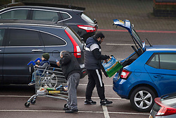 © Licensed to London News Pictures. 10/11/2020. London, UK. Busy parking lot at Tesco Extra in Edmonton, north London. Members of the public have been warned to book their Christmas delivery slots earlier, as the huge spike in demand could make stores struggling to keep up with deliveries. Photo credit: Marcin Nowak/LNP