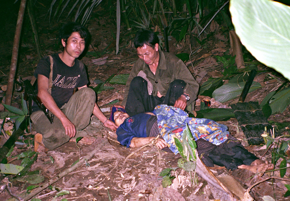 Mrs. Doua Thao, 30 years old, killed April 6, 2006...Pictured are a group of Hmong people who report an attack against them April 6, 2006 by Lao and Vietnamese military forces.  26 people perished, 5 were injured, and 5 babies died shortly after because their dead mothers could not breast-feed them.  Only one adult male was killed, the other 25 victims were women and children (17 children).  ..