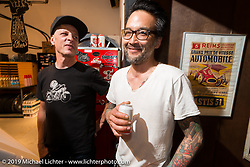 Kim Boyle and Keino Sasaki at the pre-party for the Handbuilt Motorcycle Show at Revival Cycles. Austin, TX. April 9, 2015.  Photography ©2015 Michael Lichter.