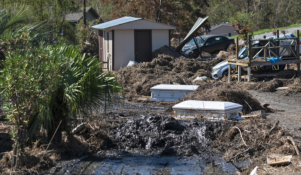 Coffins dislodged by a storm surge in Ironton