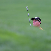 Jim Furyk watches his chip shout from the sand trap on the 18th hole land close to the pin during the third round of theThe Barclays Golf Tournament at The Ridgewood Country Club, Paramus, New Jersey, USA. 23rd August 2014. Photo Tim Clayton