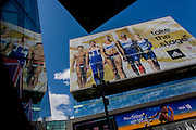 The giant presence of Team GB role-model athlete heroes on the side of the their HQ at the Westfield City shopping complex, Stratford that leads to the Olympic Park during the London 2012 Olympics, the 30th Olympiad. The ads are for Visa and for sports footwear brand Adidas and their 'Take the Stage' campaign including diver Tom Daley, gymnast Louis Smith and the darling of British athletics, heptathlete gold medallist Jessica Ennis. Situated on the fringe of the 2012 Olympic park, Westfield is Europe's largest urban shopping centre providing the main access to the Olympic park with a central 'street' giving 75% of Olympic visitors access to the main stadium so retail space..