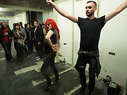 PERFORMANCE DANCING TO SUZI QUATRO, THE ARTIST IS MATHEW SMITH DARK HAIR, Open Heart Surgery, mixed exhibition organised by the Moving Museum, 180  The Strand. London. 12 October 2013.