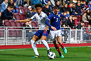 Reiss Nelson England U21s (Hoffenheim, loan from Arsenal) & Greg Taylor Scotland U21s (Kilmarnock FC) battle for the ball during the U21 UEFA EUROPEAN CHAMPIONSHIPS match Scotland vs England at Tynecastle Stadium, Edinburgh, Scotland, Tuesday 16 October 2018.