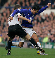 Photo: Dave Howarth.<br /> Everton v Charlton Athletic. The Barclays Premiership.<br /> 02/01/2005. Everton's Tim Cahil is held up by Charlton's Matt Holland