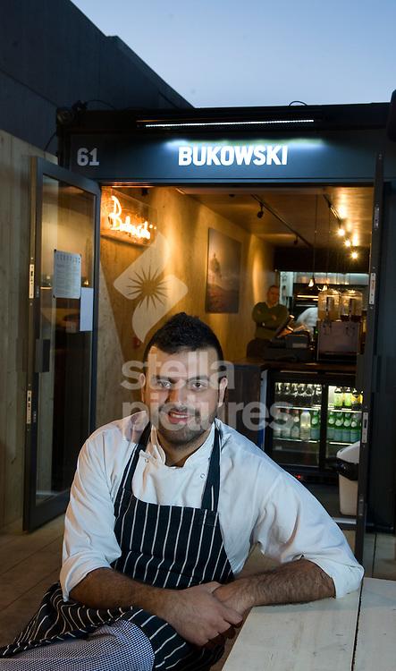 Picture by Daniel Hambury. .9/12/11.Chef/owner Alberto Figueroa of Bukowski Grill in Shoreditch, east London.