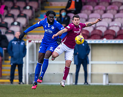 06MAR21 Queen of the South's Ayo Obileye and Arbroath's David Hilson. Arbroath 2 v 4 Queen of the South, Scottish Championship played 6/3/2021 at Arbroath's home ground, Gayfield Park.