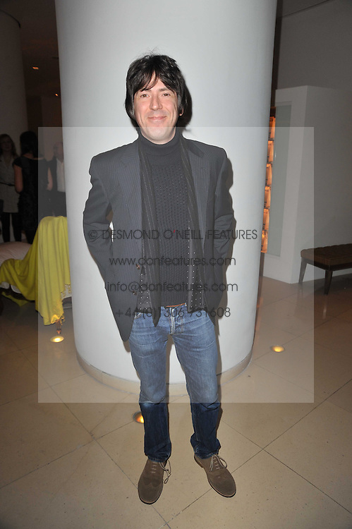 Musician MARK COLLINS from The Charlatans at a Burns Night dinner in aid of cancer charity CLIC Sargent held at St.Martin's Lane Hotel, London on 25th January 2011.