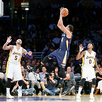 07 December 2014: New Orleans Pelicans center Alexis Ajinca (42) takes a jump shot over Los Angeles Lakers forward Carlos Boozer (5) during the New Orleans Pelicans 104-87 victory over the Los Angeles Lakers, at the Staples Center, Los Angeles, California, USA.