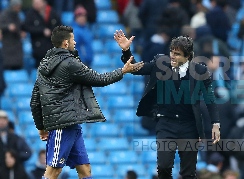 Diego Costa of Chelsea celebrates with Antonio Conte manager of Chelsea during the Premier League match at the Etihad Stadium, Manchester. Picture date: December 3rd, 2016. Pic Simon Bellis/Sportimage