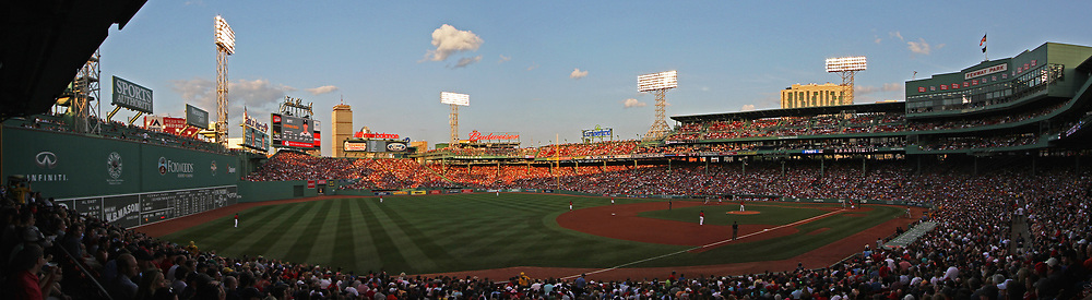 Red Sox Nation at Boston Fenway Park playing against the New York Yankees at Fenway Park. This sport photo shows Boston Fenway Park and Boston skyline with its iconic landmarks like the Prudential center and John Hancock building on a beautiful summer night. P<br /> <br /> Boston Fenway Park is the jewel of ballparks and the oldest ballpark in America. The romance began in 1912 when a century of jubilation and heartbreak began.<br /> <br /> Photo prints are available at <br /> <br /> https://juergen-roth.pixels.com/featured/red-sox-yankees-rivalry-juergen-roth.html<br /> <br /> Good light and happy photo making!<br /> <br /> My best,<br /> <br /> Juergen