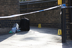 © Licensed to London News Pictures. 22/09/2016. LONDON, UK.  Forensic markers and equipment at the scene. A man was found dead in the street following a suspected assault, near All Saints DLR station just before midnight last night.  Photo credit: Vickie Flores/LNP