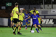 AFC Wimbledon striker Egli Kaja (21) dribbling and holding off a Burton player during the Pre-Season Friendly match between AFC Wimbledon and Burton Albion at the Cherry Red Records Stadium, Kingston, England on 21 July 2017. Photo by Matthew Redman.