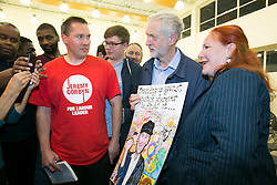 © Licensed to London News Pictures. 08/09/2015. Nuneaton, North Warwickshire, UK. Labour leader contender JEREMY CORBYN taking part in a rally at North Warks and Hinckley College. Jeremy held his first rally in Nuneaton and now holds his last the 98th in Nuneaton. Pictured with supporters, MARK MAGUIRE, left in Corbyn shirt and JO SHAKESPEARE who gave Jeremy the drawing pictured. Photo credit : Dave Warren/LNP