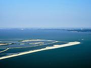 Nederland, Flevoland, Markermeer, 26-08-2019; Marker Wadden in het Markermeer. Zuidpunt, gezien  naar Lelystad. Doel van het project van Natuurmonumenten en Rijkswaterstaat is natuurherstel, met name verbetering van de ecologie in het gebied, in het bijzonder de kwaliteit van bodem en water<br /> Naast het hoofdeiland is er inmiddels een tweede eiland in wording, de uiteindelijk Marker Wadden archipel zal uit vijf eilanden bestaan. <br /> Marker Wadden, artifial islands. The aim of the project is to restore the ecology in the area, in particular the quality of soil and water.<br /> The first phase of the construction, the main island, is finished. <br /> <br /> luchtfoto (toeslag op standard tarieven);<br /> aerial photo (additional fee required);<br /> copyright foto/photo Siebe Swart