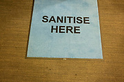 Sanitise here mat on 9th July, people in Birmingham, United Kingdom. After months of lockdown, but with case numbers rising, in particular that of the Delta Variant, people are still encouraged to use hand sanitiser.